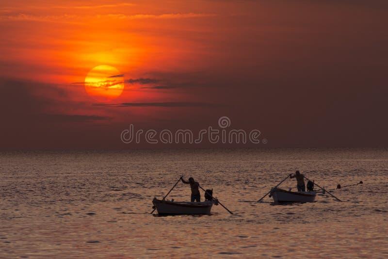 Rovinj - Croatia - Fishermen at sunset royalty free stock photography