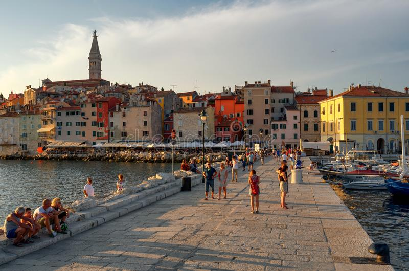 Tourists on a pier in the old town of Rovinj at sunset, Istrian Peninsula, Croatia stock image