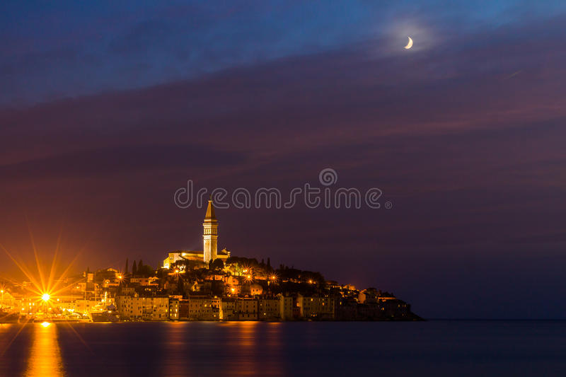 Rovinj old town at night with moon on the colorful sky, Adriatic sea coast of Croatia, Europe royalty free stock photography