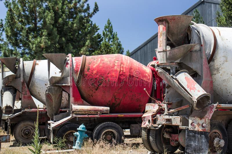 Row Of Abandoned Cement Mixers. Row Of Abandoned Cement Mixer Vehicles In Old Salvage Yard Area stock photography