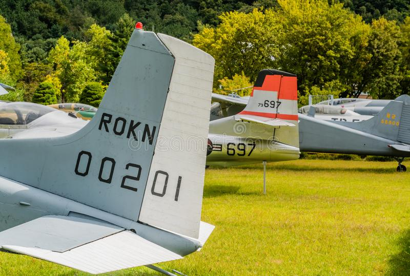 Row of aircraft tail sections. Daejeon, South Korea; October 3, 2019: Tail section of various aircraft in a row on display at National Cemetery royalty free stock photos
