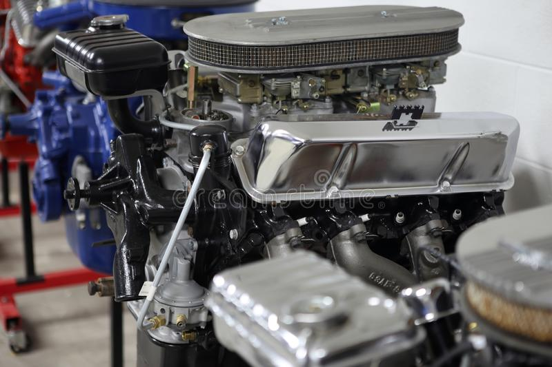 Row of American V8 engines. In an automotive shop stock photography