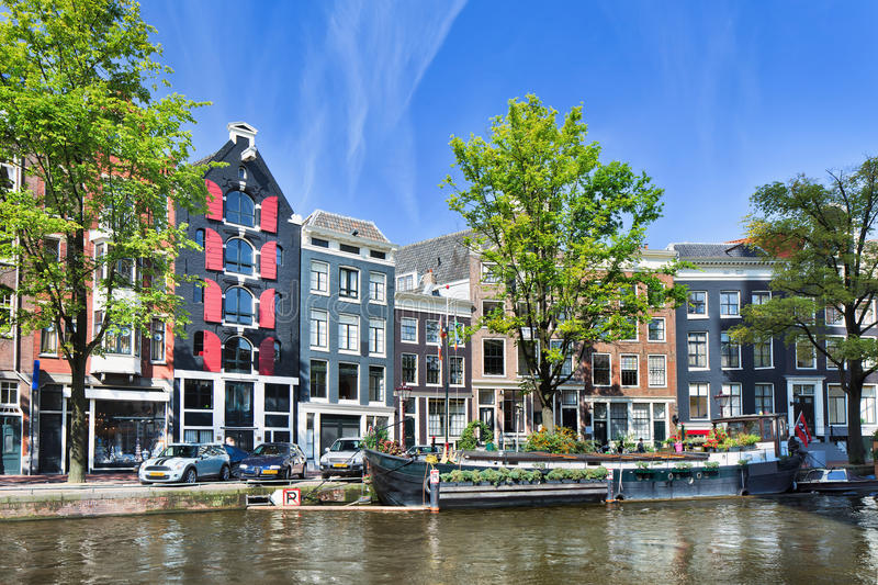 Row of ancient mansions near a canal, Amsterdam, netherlands stock photos