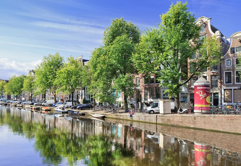 Row of ancient renovated mansions near a canal, Amsterdam, Netherlands stock photo