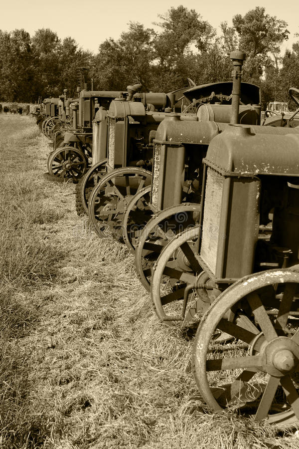 Download Row Of Antique Tractors Sepia Stock Image - Image: 17595009