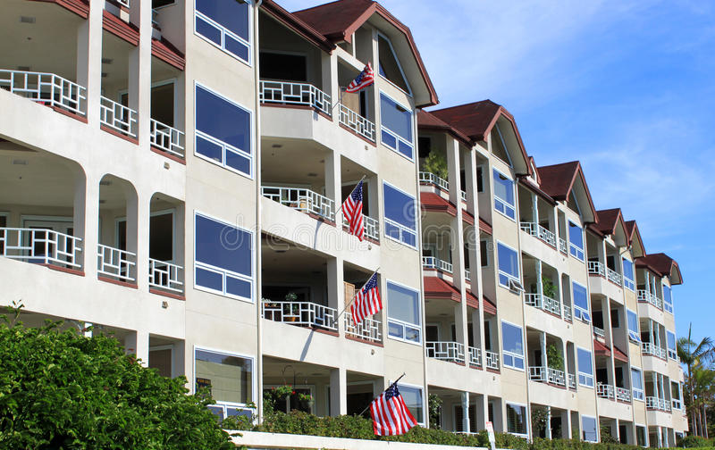 Row of apartment buildings stock images