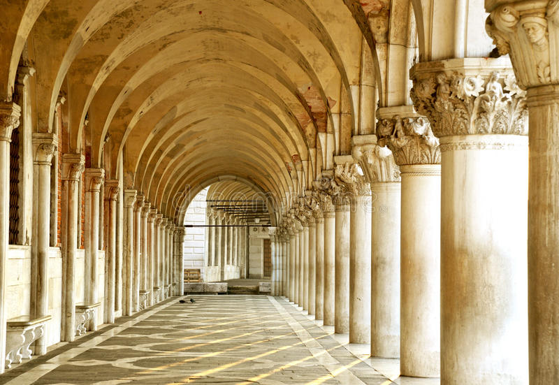 Row of arches underneath the Doge's Palace in Piazza San Marco in Venice. The famouse place in Venice.  stock photos