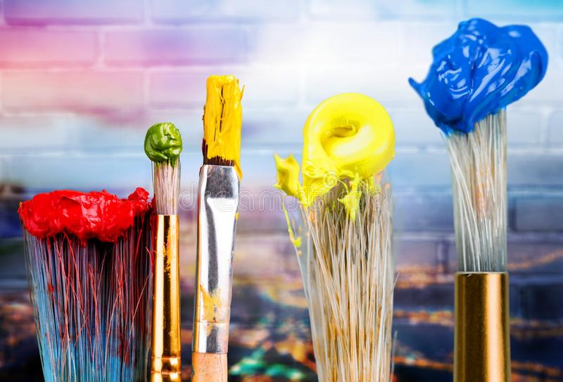 Row of artist paint brushes on background. Row art paint artistic artist brushes green royalty free stock photo