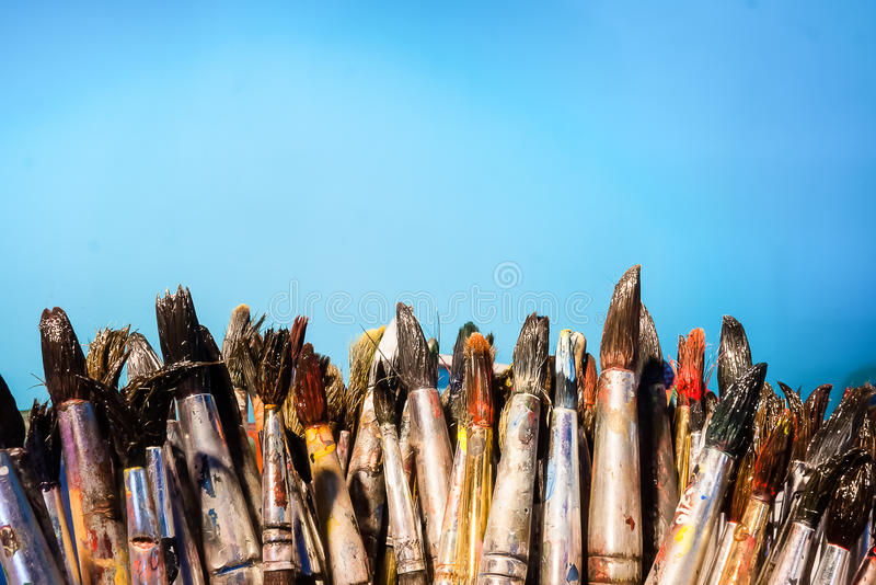 Row of artist paintbrushes stock photos
