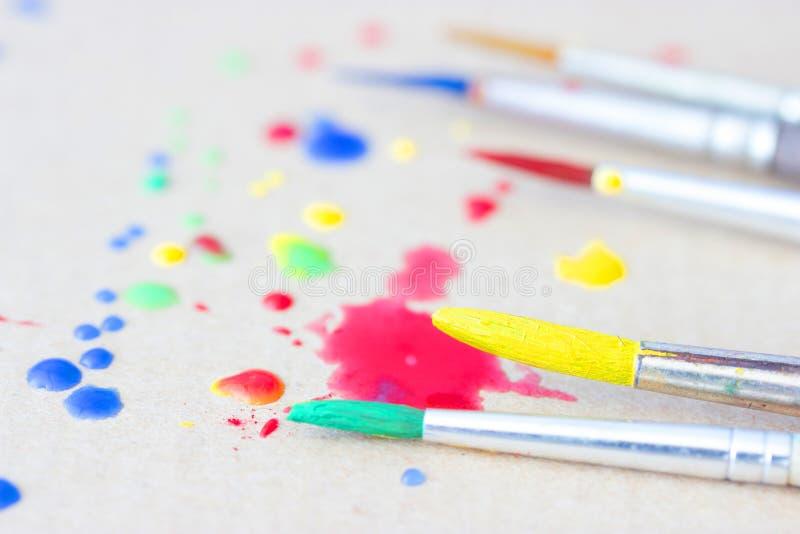 Row of artist paintbrushes closeup stock photos