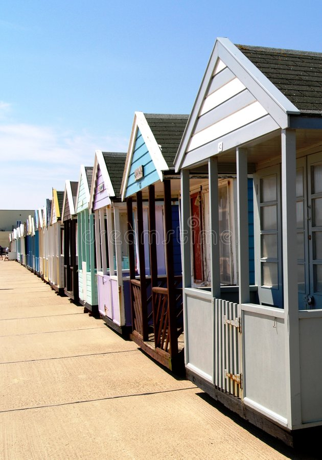 Row of beach chalets or huts. Row of colorful beach chalets or huts on beach promenade, Southwold, Suffolk, England royalty free stock photo