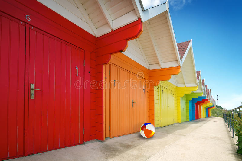 Row of beach huts on bright summer day royalty free stock images