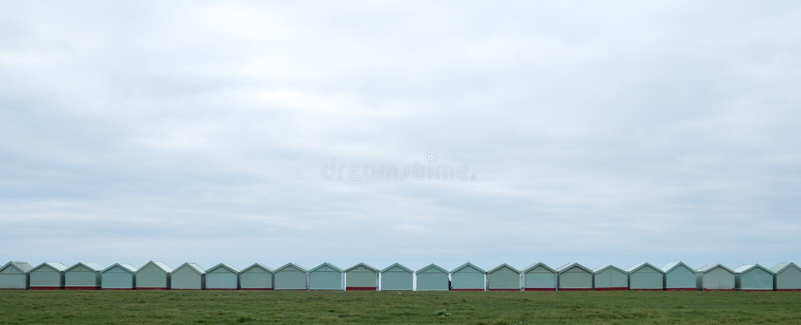 Row of beach huts on the sea front in Hove, Sussex UK. Row of beach huts on the sea front in Hove, East Sussex uK royalty free stock image
