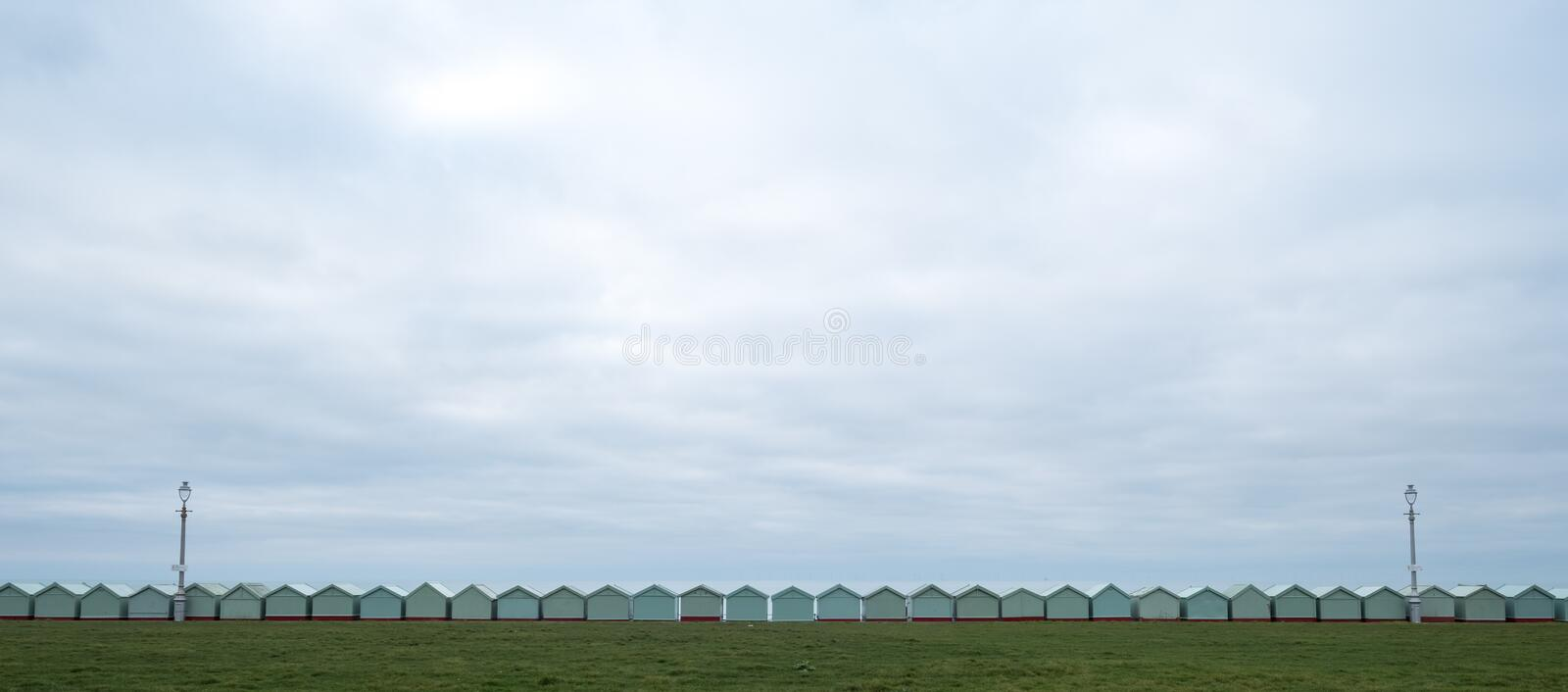 Row of beach huts on the sea front in Hove, Sussex UK. Row of beach huts on the sea front in Hove, East Sussex uK stock photo