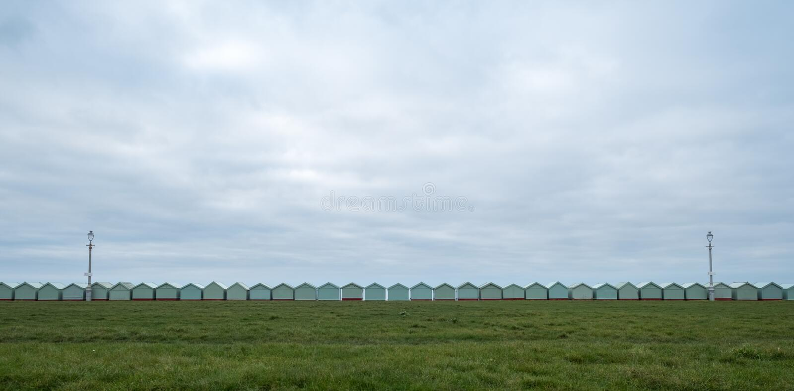 Row of beach huts on the sea front in Hove, Sussex UK. Row of beach huts on the sea front in Hove, East Sussex uK stock image