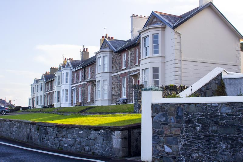 A row of beautiful tradional Victorian terrace houses with a sea. 11 October 2018 A row of beautiful tradional Victorian terrace houses with a sea view on the stock photo