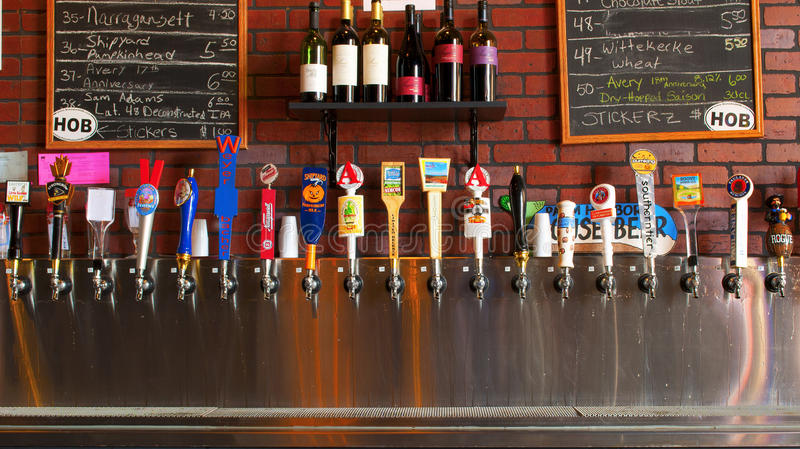 Row of Beer Taps Craft Beers. Row of beer taps from craft beers of the world