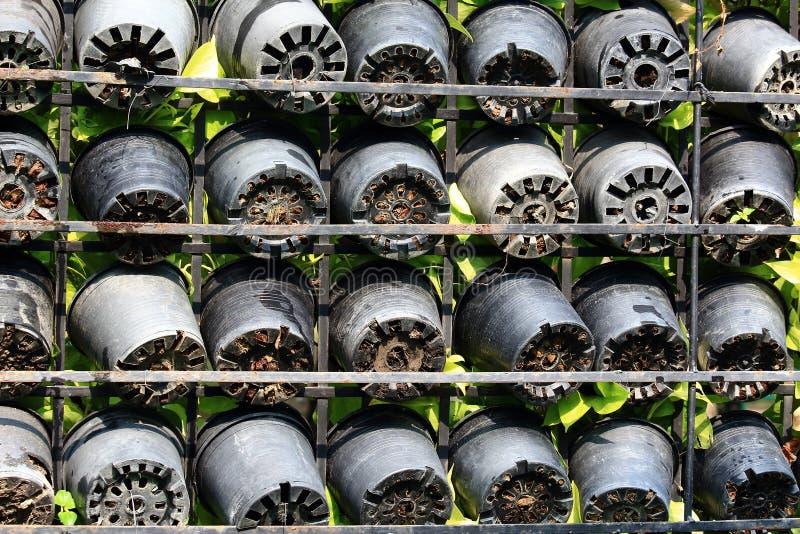 Row of Black Plastic Jardiniere royalty free stock photos