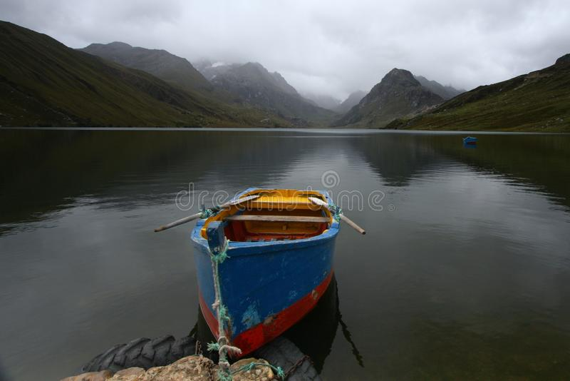 Download Row boat on a lake stock image. Image of mountain, dinghy - 27864683