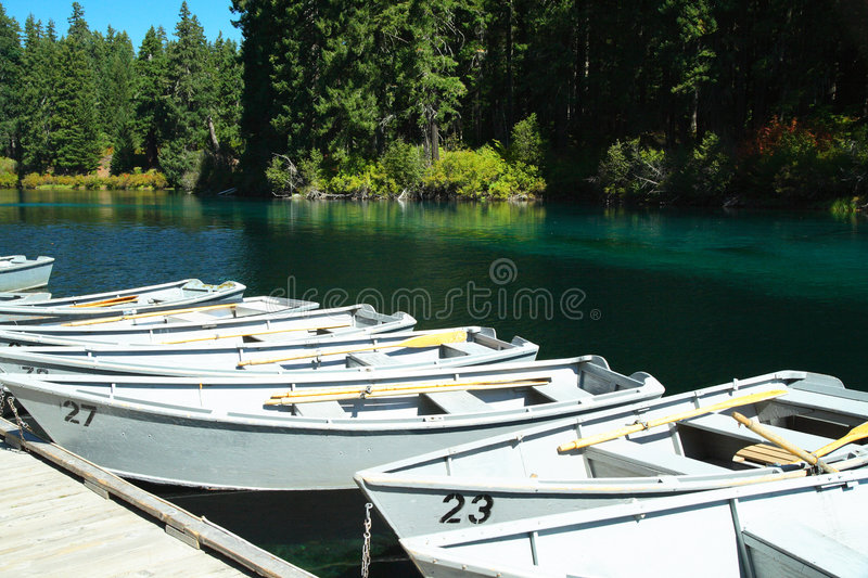 Row boats. Rental row boats tied to the dock on a cascade lake royalty free stock images