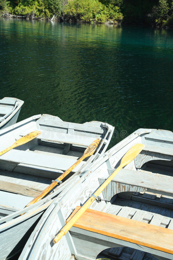 Row boats. Rental row boats tied to the dock on a cascade lake stock photography