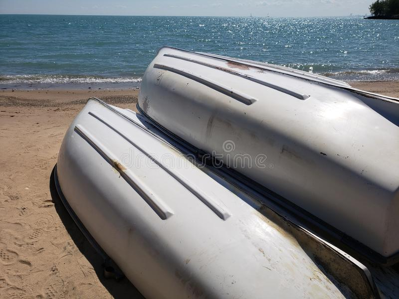 Row boats on a beach royalty free stock image