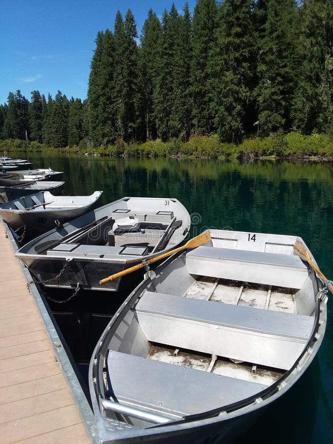 Row Boats at the Dock. At Clear Lake, Oregon.  This is in the Pacific Northwest area of the United States royalty free stock image