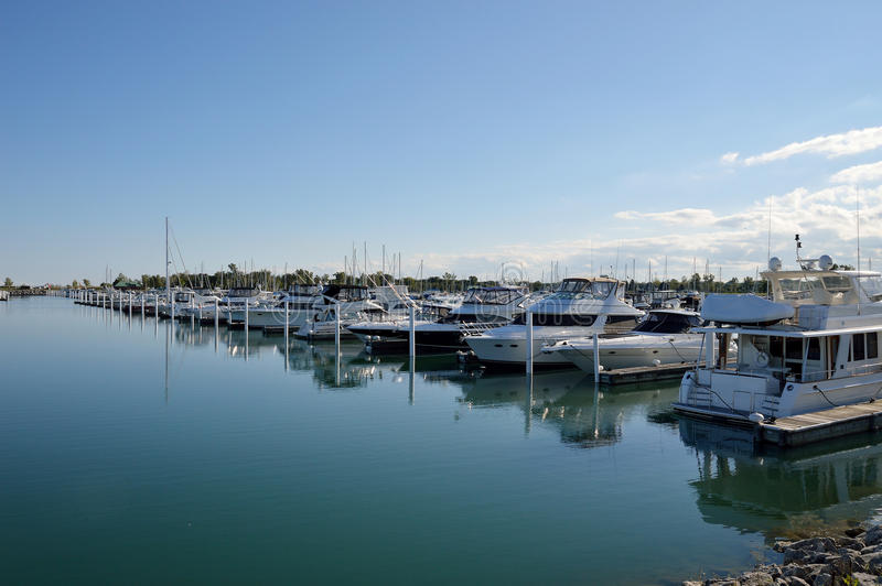 Row of boats in harbor royalty free stock photography