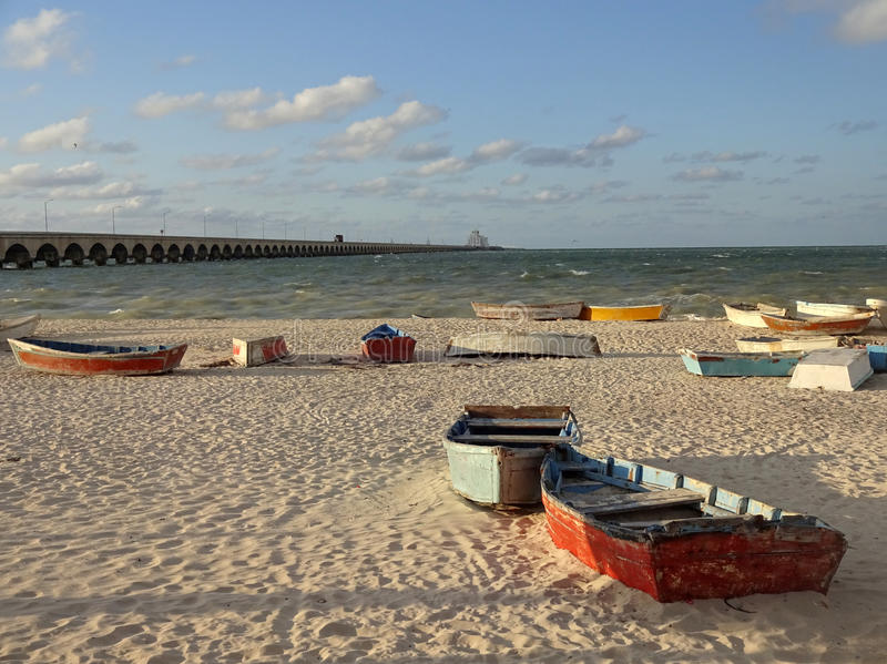 Row Boats at Sunset. Photo of row boats and progreso beach in yucatan mexico at sunset. This beach is located near merida and is very popular stock images