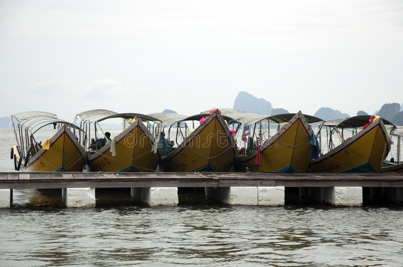 Row boats in Thailand. The weather was rainy and foggy, but this country has a very different texture royalty free stock photo