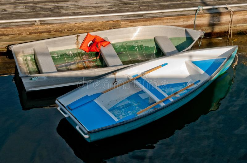 Row boats. Tied to dock royalty free stock images