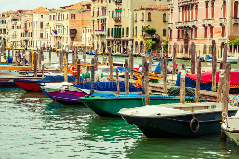 Row of boats in Venice, Italy. Row of small wooden boats floating on water in Venice, Italy stock photo