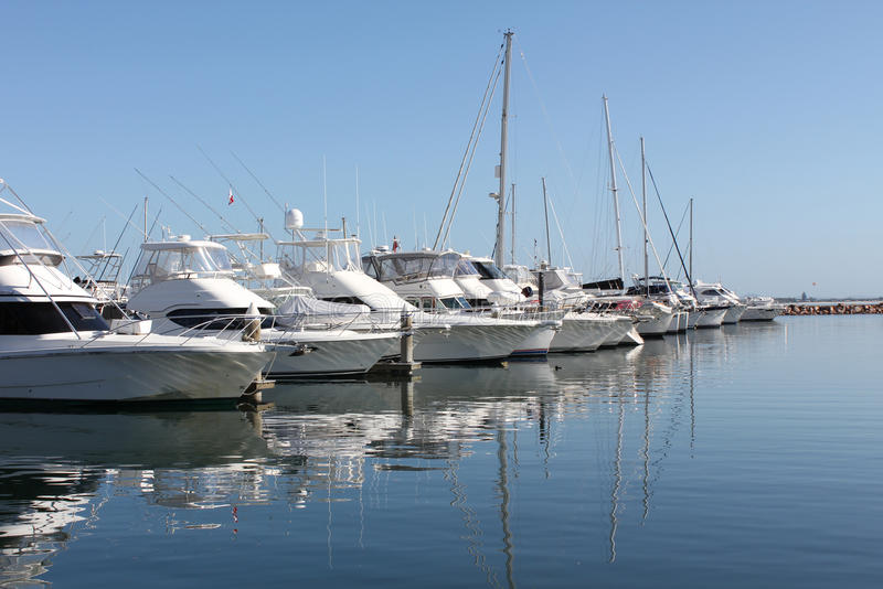 Row of boats and yachts. Row of docked boats and yachts stock images