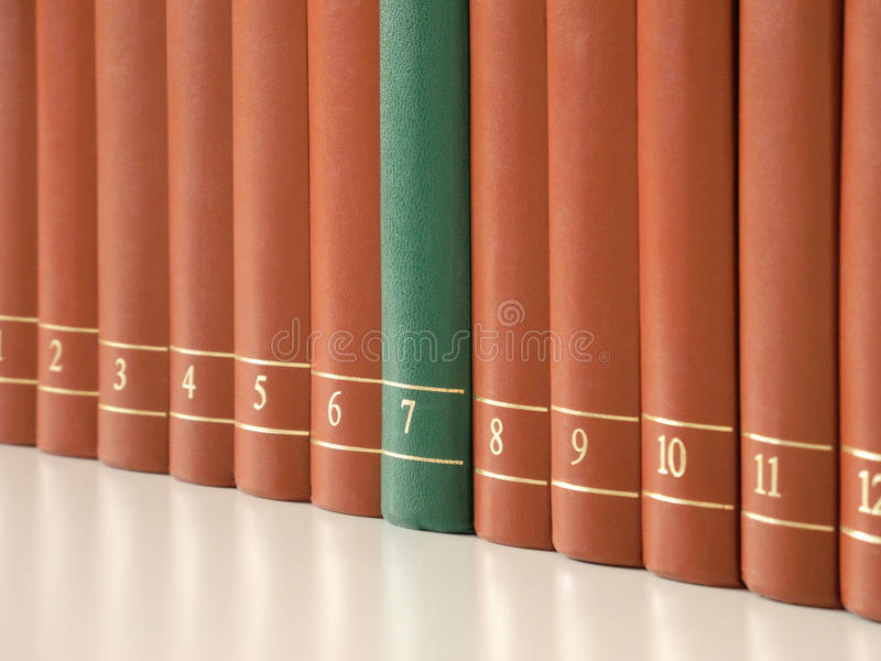 Row of books. Symbolic image showing 12 books with leather cover in a row - one book seems to be specific stock image
