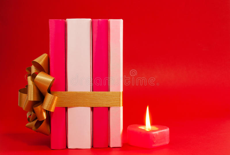 Download Row Of Books Tied Up With Ribbon And Candle Stock Photo - Image: 23352202