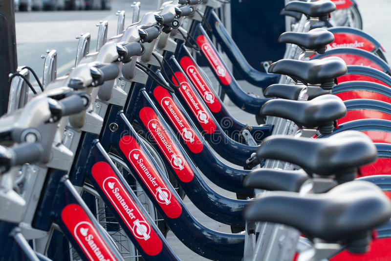 A Row Of Boris Bikes. LONDON, UK - JANUARY 20, 2017. A row of Boris Bikes sponsored by Santander Bank which are a bicycle hire scheme in London, England and a royalty free stock photos