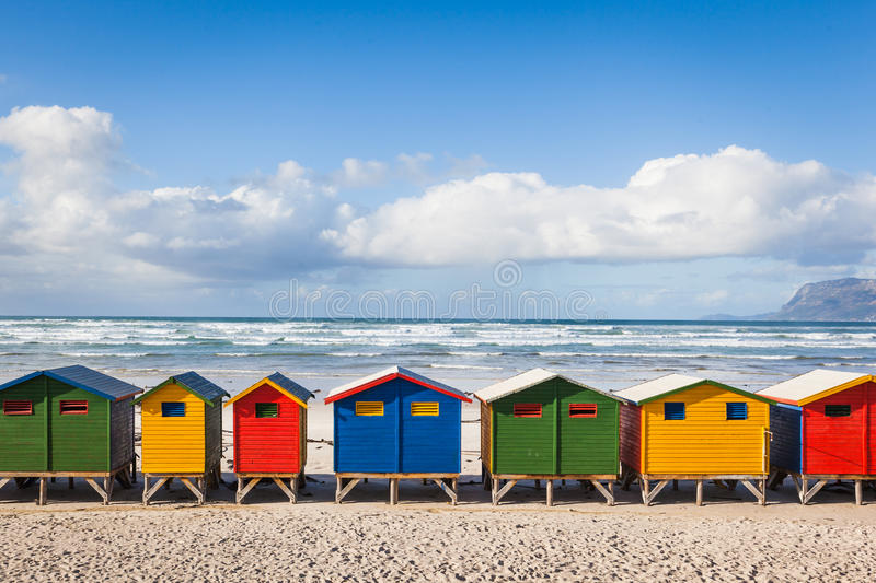 Row of brightly colored huts in Muizenberg beach. Muizenberg stock images