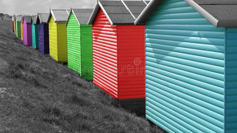 Row of brightly coloured beach huts stock image