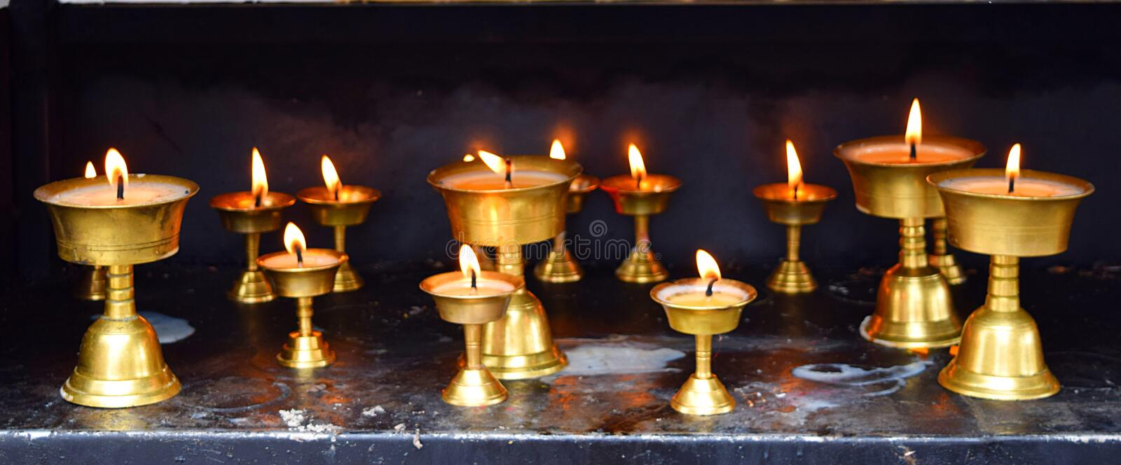 Row of Bronze Lamps - Diwali Festival in India - Spirituality, Religion and Worship. This is a photograph of row of oil lamps - called diyas - which represents royalty free stock image