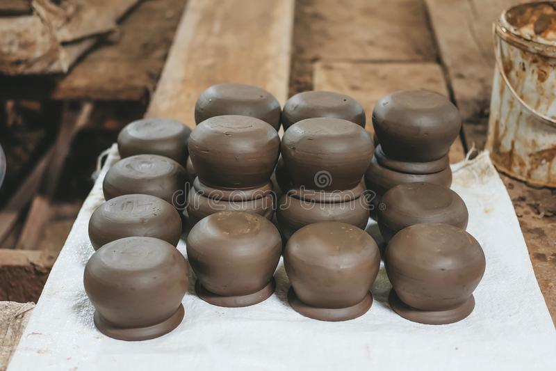 Row of Brown earthenware pot. Thailand art made by hand royalty free stock photos