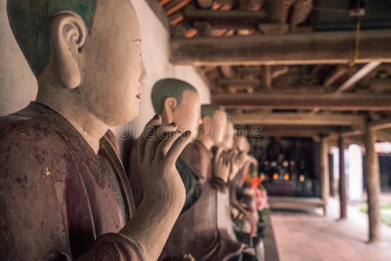 A row of buddah statues in vietnam stock images