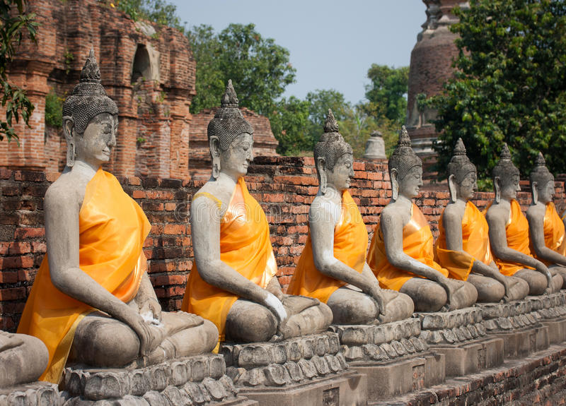 Row of Buddha statues stock photos