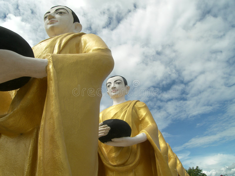 Row of Buddhas 2. A row of Buddha statues standing in peace royalty free stock photo