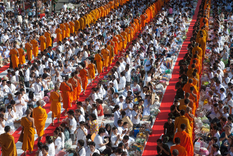 Row of Buddhist monks for peoples give food offerings.