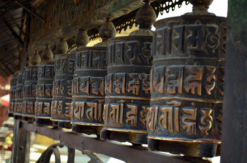 Row of buddhist prayer drums wheels rolls in Swayambhu Swayambhunath Temple royalty free stock images