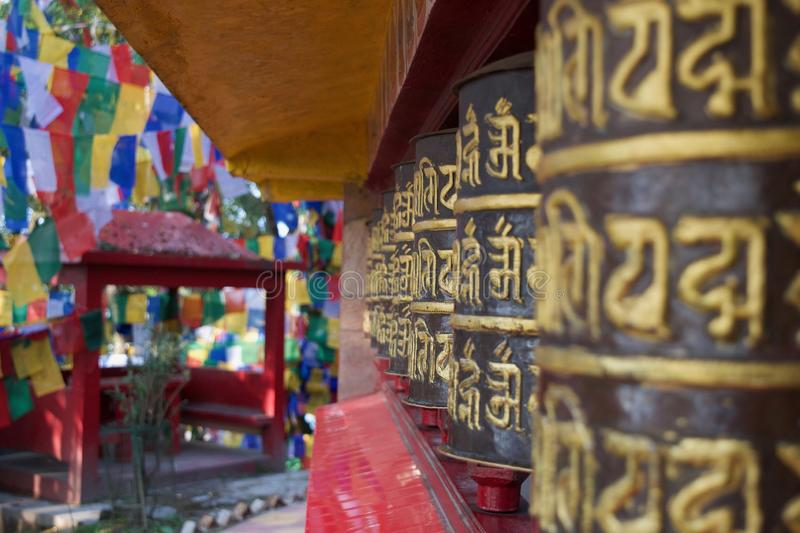 Row of Buddhist Prayer Wheels at a monastery stock images