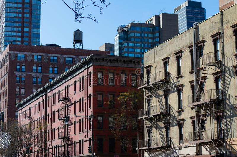 Row of Buildings and Skyscrapers in Lincoln Square New York. A row of old and new buildings and skyscrapers with fire escapes in Lincoln Square in New York City stock photo