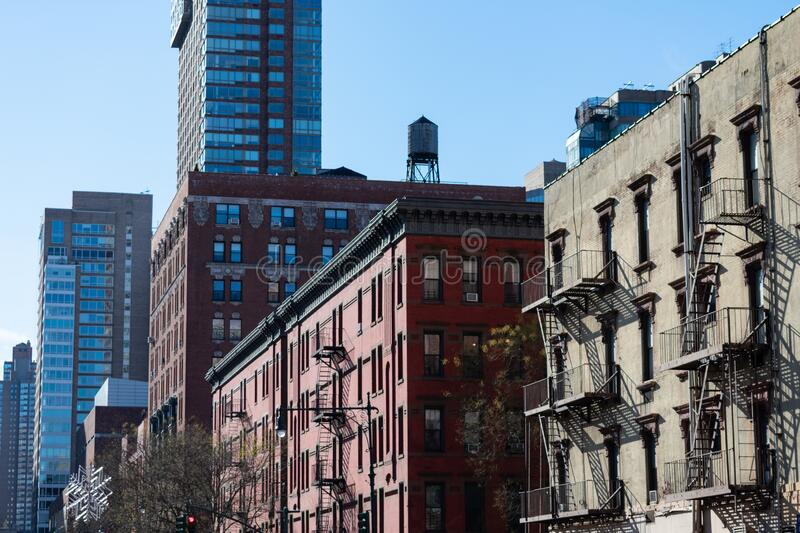 Row of Buildings and Skyscrapers in Lincoln Square New York. A row of old and new buildings and skyscrapers with fire escapes in Lincoln Square in New York City stock photos