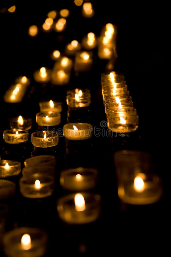 Row of burning candles royalty free stock image