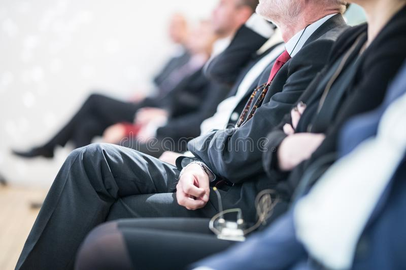 Row of business people sitting at seminar. stock photos